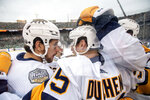 Nashville Predators left wing Filip Forsberg, left, congratulates center Matt Duchene (95) after Duchene's goal against the Dallas Stars in the first period of the NHL Winter Classic hockey game between the Dallas Stars and the Nashville Predators at the Cotton Bowl, Wednesday, Jan. 1, 2020, in Dallas. (AP Photo/Jeffrey McWhorter)