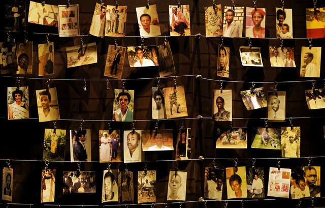 FILE - In this Friday, April 5, 2019 file photo, family photographs of some of those who died hang on display in an exhibition at the Kigali Genocide Memorial centre in the capital Kigali, Rwanda. Rwanda's government has written to France requesting the extradition of the former head of Rwanda's military intelligence service Maj. Gen. Aloys Ntiwiragabo, a key suspect in the East African nation's genocide a quarter-century ago, officials said Wednesday, Aug. 26, 2020. (AP Photo/Ben Curtis, File)