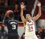 Miami's Anthony Lawrence II (3) looks to shoot past Virginia Tech's Kerry Blackshear Jr. (24) during the first half of NCAA college basketball game in Blacksburg, Va., Friday, March 8, 2019. (Matt Gentry/The Roanoke Times via AP)