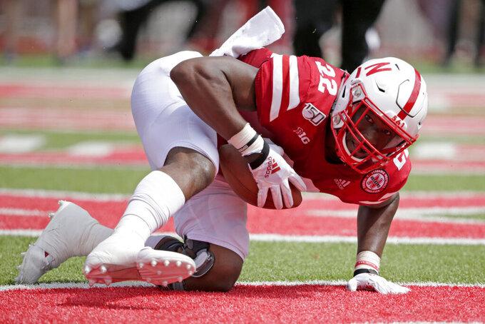 Nebraska linebacker Alex Davis (22) recovers a fumble by South Alabama quarterback Cephus Johnson for a touchdown during the second half of an NCAA college football game in Lincoln, Neb., Saturday, Aug. 31, 2019. Nebraska won 35-21. (AP Photo/Nati Harnik)