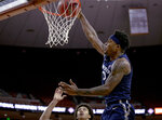 Xavier forward Tyrique Jones (0) dunks Texas during an NCAA college basketball game in the second round of the NIT on Sunday, March 24, 2019, in Austin, Texas. (Nick Wagner/Austin American-Statesman via AP)
