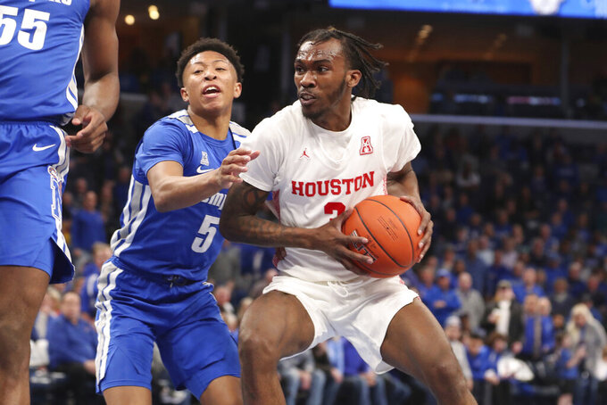 Houston guard DeJon Jarreau (3) looks to pass as Memphis guard Boogie Ellis (5) defends in the first half of an NCAA college basketball game Saturday, Feb. 22, 2020, in Memphis, Tenn. (AP Photo/Karen Pulfer Focht)