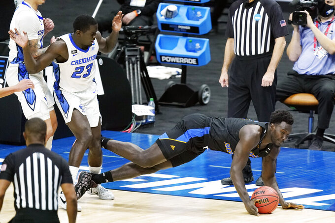 UC Santa Barbara's Amadou Sow, right, collides with Creighton's Damien Jefferson (23) during the second half of a college basketball game in the first round of the NCAA tournament at Lucas Oil Stadium in Indianapolis Saturday, March 20, 2021. (AP Photo/Mark Humphrey)
