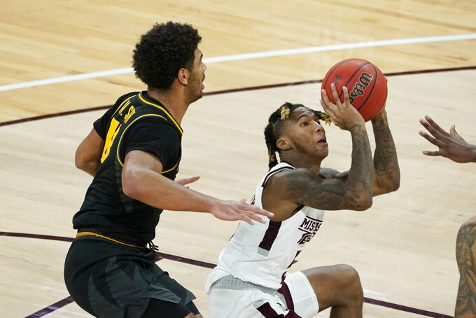 Mississippi State guard Deivon Smith, right, looks for a shot next to Missouri guard Mark Smith (13) during the first half of an NCAA college basketball game, Tuesday, Jan. 5, 2021, in Starkville, Miss. (AP Photo/Rogelio V. Solis)