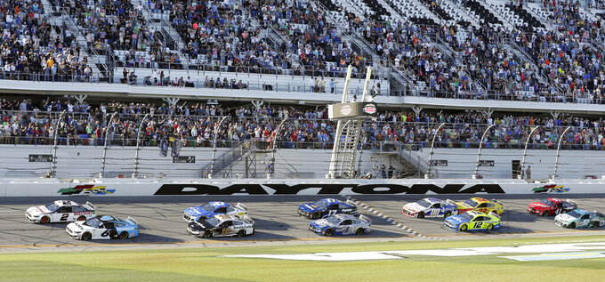 Ryan Newman (6) and Brad Keselowski (2) lead the field on a restart to resume the NASCAR Daytona 500 auto race at Daytona International Speedway, Monday, Feb. 17, 2020, in Daytona Beach, Fla. Sunday's race was postponed because of rain. (AP Photo/John Raoux)