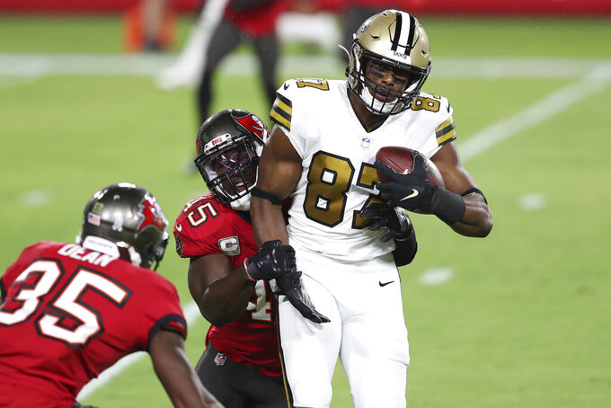 New Orleans Saints tight end Jared Cook (87) is stopped by Tampa Bay Buccaneers inside linebacker Devin White (45) and cornerback Jamel Dean (35) after a catch during the first half of an NFL football game Sunday, Nov. 8, 2020, in Tampa, Fla. (AP Photo/Mark LoMoglio)