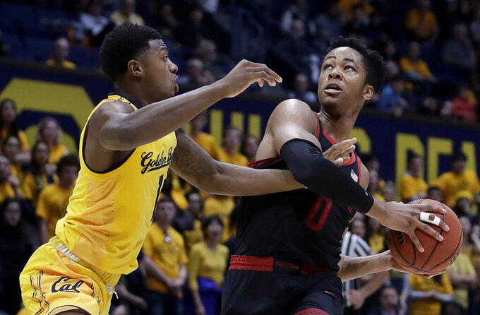 Stanford's KZ Okpala, right, looks to shoot against California's Darius McNeill in the first half of an NCAA college basketball game Sunday, Feb. 3, 2019, in Berkeley, Calif. (AP Photo/Ben Margot)