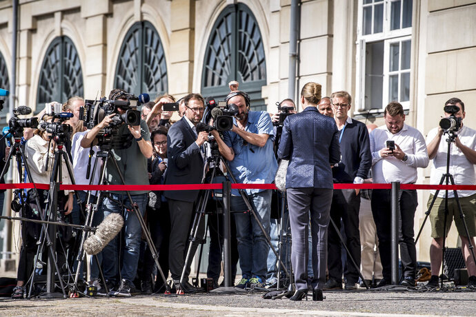 Denmark's Prime Minister Mette Frederiksen faces the media to give a statement about US President's cancellation of his scheduled State Visit, in front of the State Department in Copenhagen, Wednesday, Aug. 21, 2019.  U.S. President Trump announced his decision to postpone a visit to Denmark by tweet on Tuesday Aug. 20, 2019, after Danish Prime Minister Mette Frederiksen dismissed the notion of selling Greenland to the U.S. as