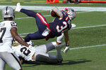 New England Patriots running back Rex Burkhead falls backward toward the end zone for a touchdown in the second half of an NFL football game against the Las Vegas Raiders, Sunday, Sept. 27, 2020, in Foxborough, Mass. (AP Photo/Steven Senne)