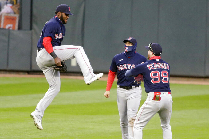 Boston Red Sox center fielder Franchy Cordero (16) jumps to celebrate with teammates right fielder Enrique Hernandez (5) and center fielder Alex Verdugo (99) after defeating the Minnesota Twins in the second baseball game of a doubleheader, Wednesday, April 14, 2021, in Minneapolis. The Red Sox defeated the Twins 7-1. (AP Photo/Andy Clayton-King)