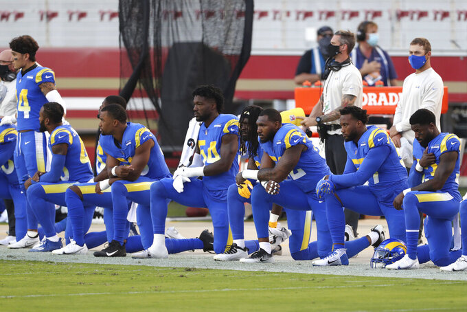 Los Angeles Rams players kneel during the national anthem before an NFL football game against the San Francisco 49ers in Santa Clara, Calif., Sunday, Oct. 18, 2020. (AP Photo/Jed Jacobsohn)