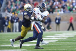 File-Virginia wide receiver Joe Reed (2) runs after making a catch in front of Notre Dame linebacker Jeremiah Owusu-Koramoah (6)in the second half of an NCAA college football game in South Bend, Ind., Saturday, Sept. 28, 2019.  Last season, the Irish defense finished 12th in scoring (17.9 points) and 18th in total yardage (321.6) per game. (AP Photo/AJ Mast, File)