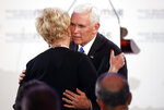 United States Vice President Mike Pence hugs Cindy McCain, widow of US Senator John McCain, after delivering his speech during the John McCain Dissertation Award Ceremony at the Bavarian State Parliament in Munich, Germany, Friday, Feb. 15, 2019. Pence arrived Thursday to attend the Munich Security Conference. (AP Photo/Matthias Schrader)