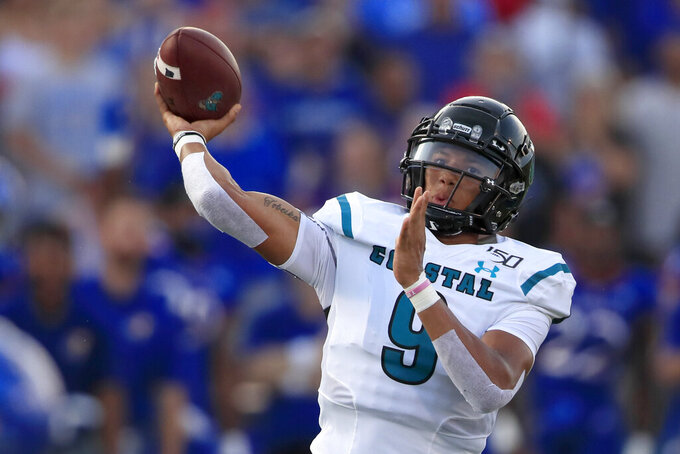 Coastal Carolina quarterback Fred Payton (9) passes to a teammate during the first half of an NCAA college football game against Kansas in Lawrence, Kan., Saturday, Sept. 7, 2019. (AP Photo/Orlin Wagner)