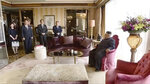 In this image made from video released by KRT on June 14, 2018, shows North Korean leader Kim Jong Un, right, sitting in a red velvet chair in his suite at the St. Regis hotel before his summit with U.S. President Donald Trump in Singapore, June 12, 2018. Through the state-run media's edited footage of the summit that aired in their country Thursday, North Koreans are getting a new look at U.S. President Donald Trump now that his summit with leader Kim Jong Un is safely over and it's a far cry from the