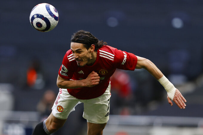 Manchester United's Edinson Cavani in action during the English Premier League soccer match between Tottenham Hotspur and Manchester United at the Tottenham Hotspur Stadium in London, Sunday, April 11, 2021. (Adrian Dennis/Pool via AP)