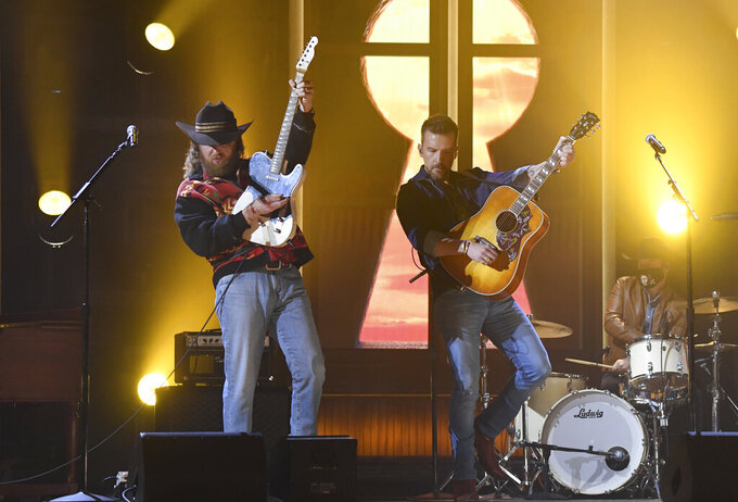 John Osborne, left, and T.J. Osborne, of Brothers Osborne, perform at the 56th annual Academy of Country Music Awards on Sunday, April 18, 2021, at the Ryman Auditorium in Nashville, Tenn. (Photo by Amy Harris/Invision/AP)