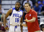 FILE - In this July 7, 2015, file photo, Philadelphia 76ers' Deonte Burton (18) speaks with his summer league coach Billy Lange during the first half of an NBA summer league basketball game in Salt Lake City. Saint Joseph's University has hired Philadelphia 76ers assistant Billy Lange as its new basketball coach, the school said Thursday, March 28, 2019.  Lange succeeds longtime coach Phil Martelli, who was fired earlier this month after three straight losing seasons. (AP Photo/Rick Bowmer, File)