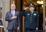 Defense Secretary Jim Mattis and Chinese Minister of Defense General Wei Fenghe, stand as the national anthems are played during an welcome ceremony at the Pentagon, Friday, Nov. 9, 2018. (AP Photo/Pablo Martinez Monsivais)