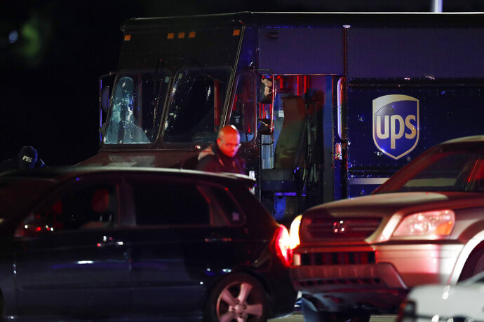 FILE - In this Dec. 5, 2019, file photo, authorities investigate the scene of a shooting in Miramar, Fla., that left four people, including a UPS driver, dead. The family of Frank Ordonez the UPS driver slain during the police shootout, have filed a lawsuit Wednesday, Sept. 16, 2020, against several law enforcement agencies. The say that officers acted negligently when they opened fire on two robbers who were holding him hostage inside his van. (AP Photo/Brynn Anderson, File)
