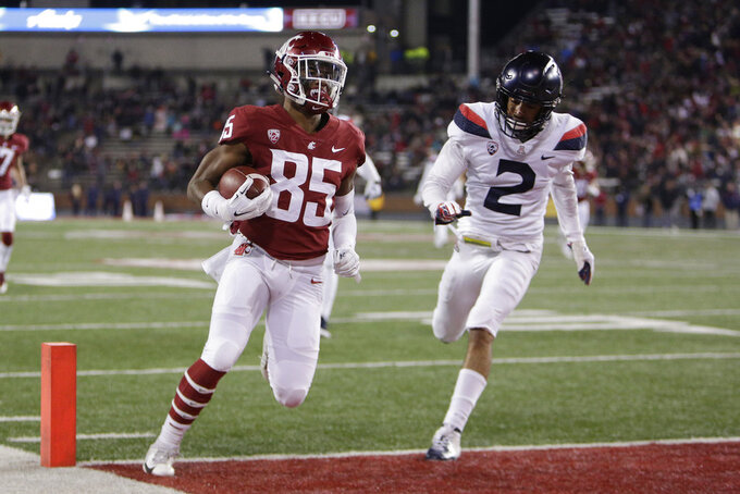 Washington State wide receiver Calvin Jackson Jr. (85) runs for a touchdown in front of Arizona cornerback Lorenzo Burns (2) during the first half of an NCAA college football game in Pullman, Wash., Saturday, Nov. 17, 2018. (AP Photo/Young Kwak)