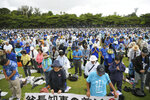 Protesters pay tribute to Okinawa Gov. Takeshi Onaga, who died last week, during a rally in Naha, Okinawa prefecture, southern Japan Saturday, Aug. 11, 2018. Tens of thousands of protesters gathered in Okinawa vowing to stop a planned U.S military base relocation on the southern Japanese island. (Yohei Nishimura/Kyodo News via AP)