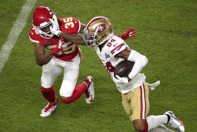 San Francisco 49ers' Kendrick Bourne (84) avoids a tackle by Kansas City Chiefs' Charvarius Ward (35), during the second half of the NFL Super Bowl 54 football game Sunday, Feb. 2, 2020, in Miami Gardens, Fla. (AP Photo/Charlie Riedel)
