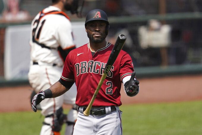 Arizona Diamondbacks' Starling Marte flips his bat after striking out against the San Francisco Giants during the fourth inning of a baseball game in San Francisco, Sunday, Aug. 23, 2020. (AP Photo/Jeff Chiu)