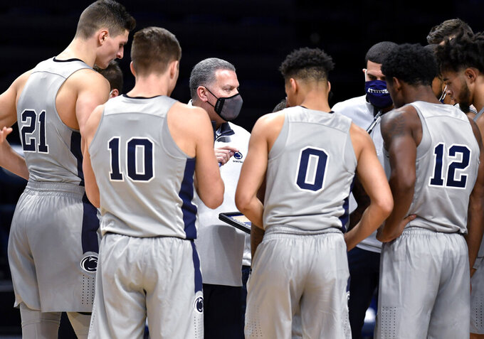 Penn State interim coach Jim Ferry talk to his players before the second half against VCU in an NCAA college basketball game Wednesday, Dec. 2, 2020, in State College, Pa. (Abby Drey/Centre Daily Times via AP)