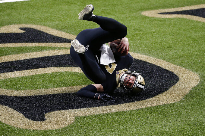 New Orleans Saints quarterback Taysom Hill (7) rolls into the end zone on a touchdown carry in the second half of an NFL football game against the Los Angeles Chargers in New Orleans, Monday, Oct. 12, 2020. (AP Photo/Butch Dill)