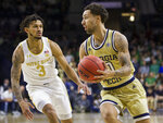 Georgia Tech's Jose Alvarado (10) drives around Notre Dame's Prentiss Hubb (3) during the first half of an NCAA college basketball game Saturday, Feb. 1, 2020, in South Bend, Ind. Notre Dame won 72-80. (AP Photo/Robert Franklin)