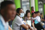 A Thai student wears mask while waiting at bus station in Bangkok, Thailand, Monday, Sept. 30, 2019. Many provinces of Thailand, including Bangkok, are shrouded with toxic smog Monday, causing concerns among people of much worst situation in the upcoming dry season when agriculture burning season really begins. (AP Photo/Sakchai Lalit)