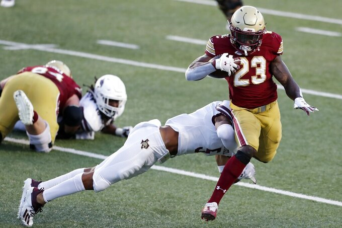 Texas State safety Kevin Anderson tackles Boston College running back Travis Levy (23) during the first half of an NCAA college football game Saturday, Sept. 26, 2020, in Boston. (AP Photo/Michael Dwyer)