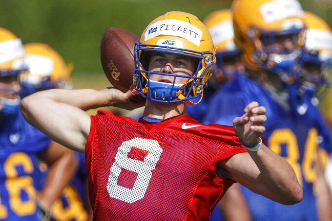 FILE - This Aug. 2, 2019, file photo shows Pittsburgh quarterback Kenny Pickett as he passes in a drill during an NCAA football practice in Pittsburgh. A preseason poll has projected Pitt to finish 4th in their ACC Coastal Division after being the division champion last season. (AP Photo/Keith Srakocic, File)nam