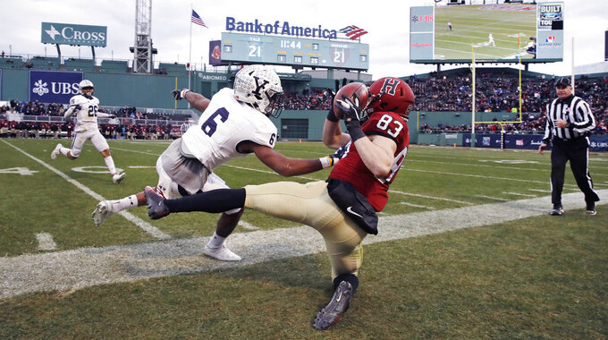 Harvard wide receiver Jack Cook (83) is forced out-of-bounds by Yale defensive back Jaelin Alburg (6) for an incomplete pass during the second half of an NCAA college football game at Fenway Park in Boston, Saturday, Nov. 17, 2018. (AP Photo/Charles Krupa)