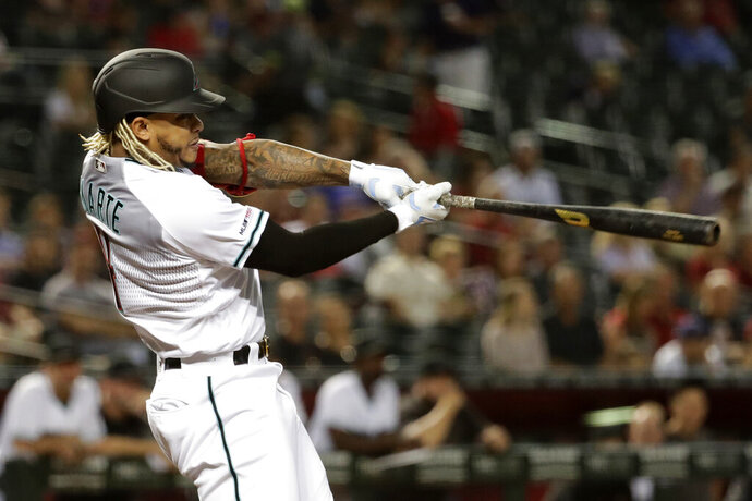 Arizona Diamondbacks' Ketel Marte follows through on a double against the Miami Marlins during the first inning of a baseball game Tuesday, Sept. 17, 2019, in Phoenix. (AP Photo/Matt York)