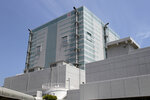 In this July 4, 2012, photo shows the No. 4 reactor building at the Fukushima Dai-ni, or No. 2, nuclear power plant in Naraha, Fukushima Prefecture, northeastern Japan. Tokyo Electric Power Company Holdings said Thursday, June 14, 2018, it was considering dismantling four reactors at the plant, which has never restarted since the 2011 disaster. If Fukushima No. 2 were to be scrapped, the number of workable reactors in Japan would fall to 35, down from 54 before the disaster. (AP Photo/Koichi Kamoshida, Pool)