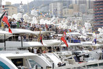 FILE - In this Saturday, May 25, 2019 file photo, spectators on yachts watch the qualifying session at the Monaco racetrack, in Monaco. Formula One's raucous circus won't be coming on May 24, 2020 for the iconic Monaco Grand Prix. The race was canceled on March 19 because of the coronavirus outbreak, with the jewel in F1′s crown removed for the first time in 66 years. (AP Photo/Luca Bruno, File)