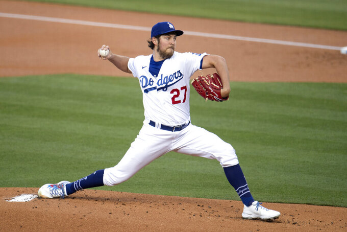 Los Angeles Dodgers starting pitcher Trevor Bauer winds up during the first inning of the team's baseball game against the San Diego Padres in Los Angeles, Saturday, April 24, 2021. (AP Photo/Kyusung Gong)