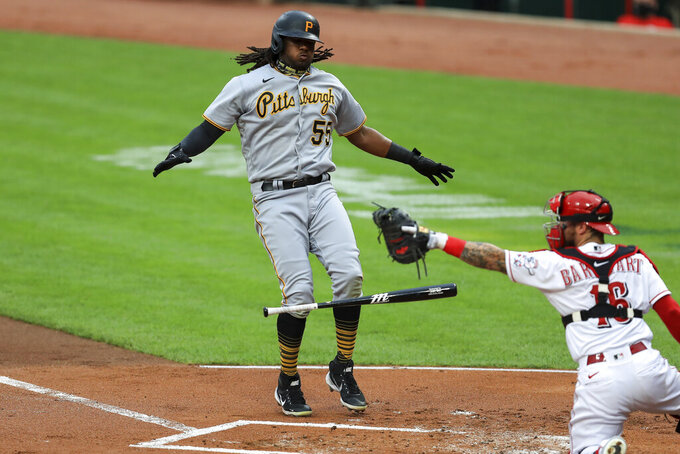 Pittsburgh Pirates' Josh Bell (55) reacts to drawing a walk as Cincinnati Reds' Tucker Barnhart (16) reacts in the first inning during a baseball game at in Cincinnati, Friday, Aug. 14, 2020. (AP Photo/Aaron Doster)