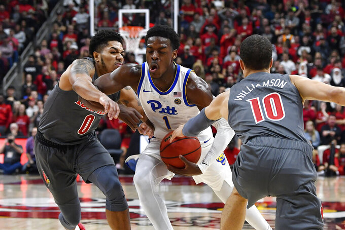 Louisville guards Lamarr Kimble (0) and Samuell Williamson (10) attempt to stop the drive of Pittsburgh guard Xavier Johnson (1) during the first half of an NCAA college basketball game in Louisville, Ky., Friday, Dec. 6, 2019. (AP Photo/Timothy D. Easley)