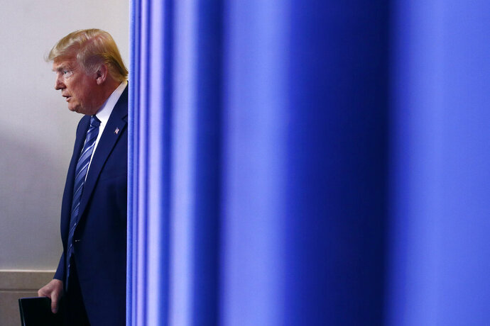 President Donald Trump arrives to speak at a coronavirus task force briefing at the White House, Sunday, April 5, 2020, in Washington. (AP Photo/Patrick Semansky)
