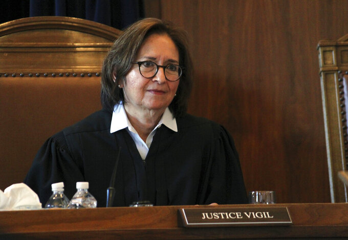 FILE - In this Wednesday, Jan. 29, 2020, file photo, New Mexico Supreme Court Justice Barbara Vigil listens to arguments in a case about the state's Energy Transition Act during a hearing in Santa Fe, New Mexico. Vigil is retiring from the New Mexico Supreme Court at the end of June 2021 after more than eight years at the high court. (AP Photo/Susan Montoya Bryan, File)