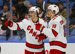 Carolina Hurricanes forwards Sebastian Aho (20) and Teuvo Teravainen (86) celebrate a goal during the second period of an NHL hockey game against the Buffalo Sabres, Thursday, Nov. 14, 2019, in Buffalo N.Y. (AP Photo/Jeffrey T. Barnes)