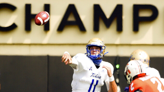 Tulsa quarterback Zach Smith throws a pass in the second half of an NCAA college football game against Oklahoma State, Saturday, Sept. 19, 2020, in Stillwater, Okla. (AP Photo/Brody Schmidt)