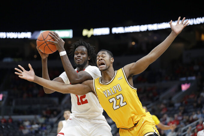 Bradley's Koch Bar (12) and Valparaiso's Mileek McMillan (22) reach for a rebound during the first half of an NCAA college basketball game in the championship of the Missouri Valley Conference men's tournament Sunday, March 8, 2020, in St. Louis. (AP Photo/Jeff Roberson)