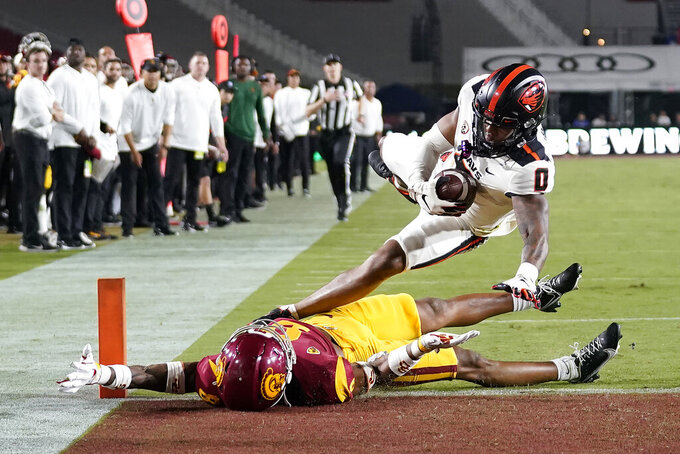 Oregon State wide receiver Tre'Shaun Harrison (0) scores a touchdown over Southern California cornerback Chris Steele during the first half of an NCAA college football game Saturday, Sept. 25, 2021, in Los Angeles. (AP Photo/Marcio Jose Sanchez)