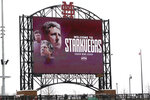 FILE - In this Jan. 10, 2020, file photo, the video board at Dudy Noble Field at Mississippi State University in Starkville, Miss., welcomes new NCAA college football head coach Mike Leach.Mississippi State's Mike Leach and Mississippi's Lane Kiffin brought big names and offensive pedigrees to the Magnolia State. But they drew huge challenges for their debuts, with the Bulldogs visiting defending national champion and No. 6 LSU and the Rebels hosting No. 5 Florida. (AP Photo/Rogelio V. Solis, FIie)