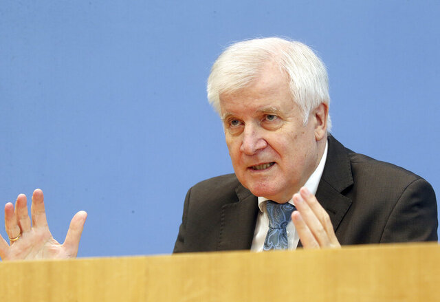 Horst Seehofer, German Minister of the Interior, attends a news conference about a report on extremism in Germany in Berlin, Germany, Tuesday, Oct. 6, 2020 (Wolfgang Kumm/Pool via AP)
