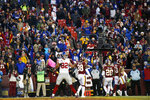 Fans react along with New York Giants tight end Kaden Smith (82) after he caught a game-winning touchdown pass from quarterback Daniel Jones during overtime of an NFL football game against the Washington Redskins, Sunday, Dec. 22, 2019, in Landover, Md. The Giants won 41-35 in overtime.(AP Photo/Alex Brandon)